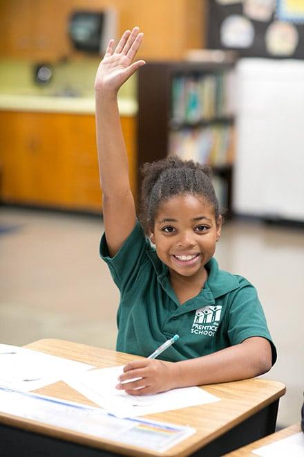 Prentice student with hand raised